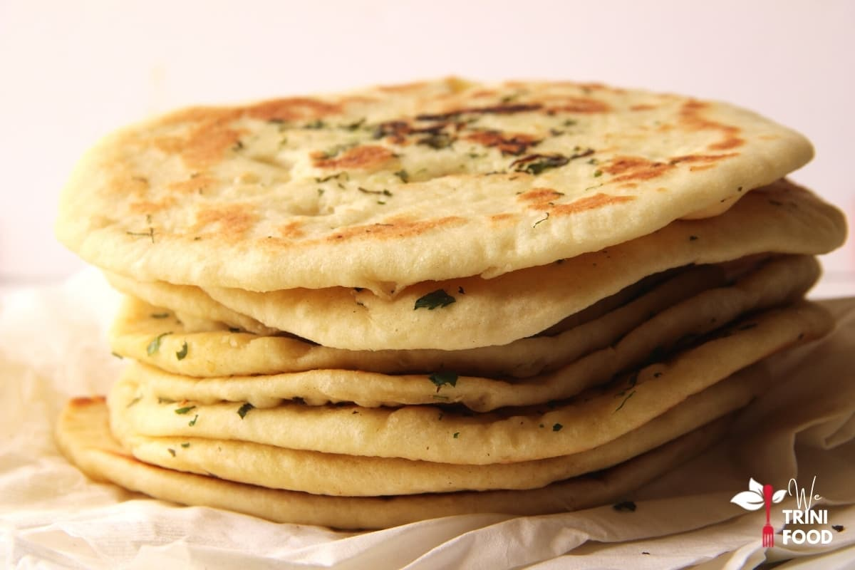 side finished garlic butter naan with cilantro