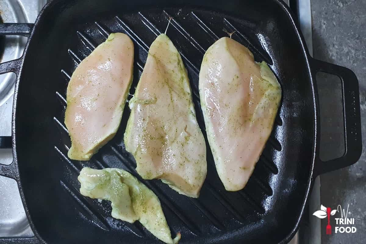 raw chicken breast on griddle pan
