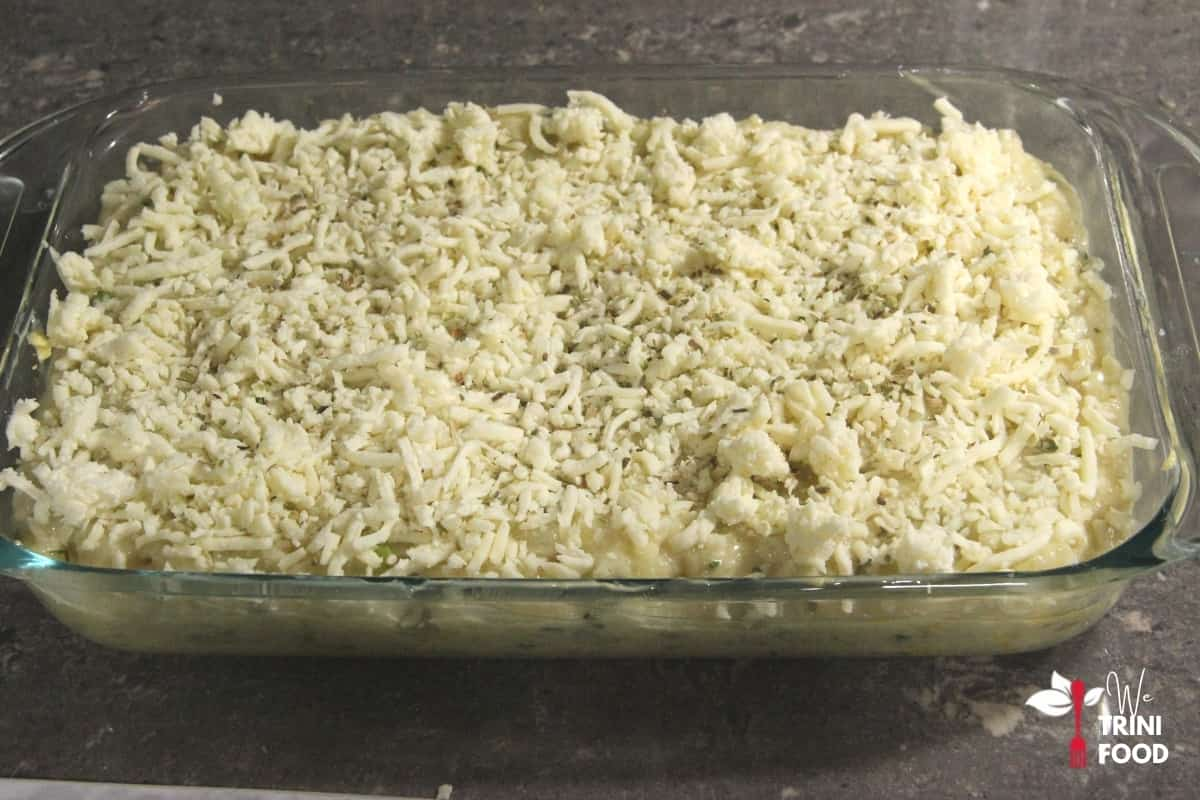 add seasoned fruit to baking tray, top with cheese